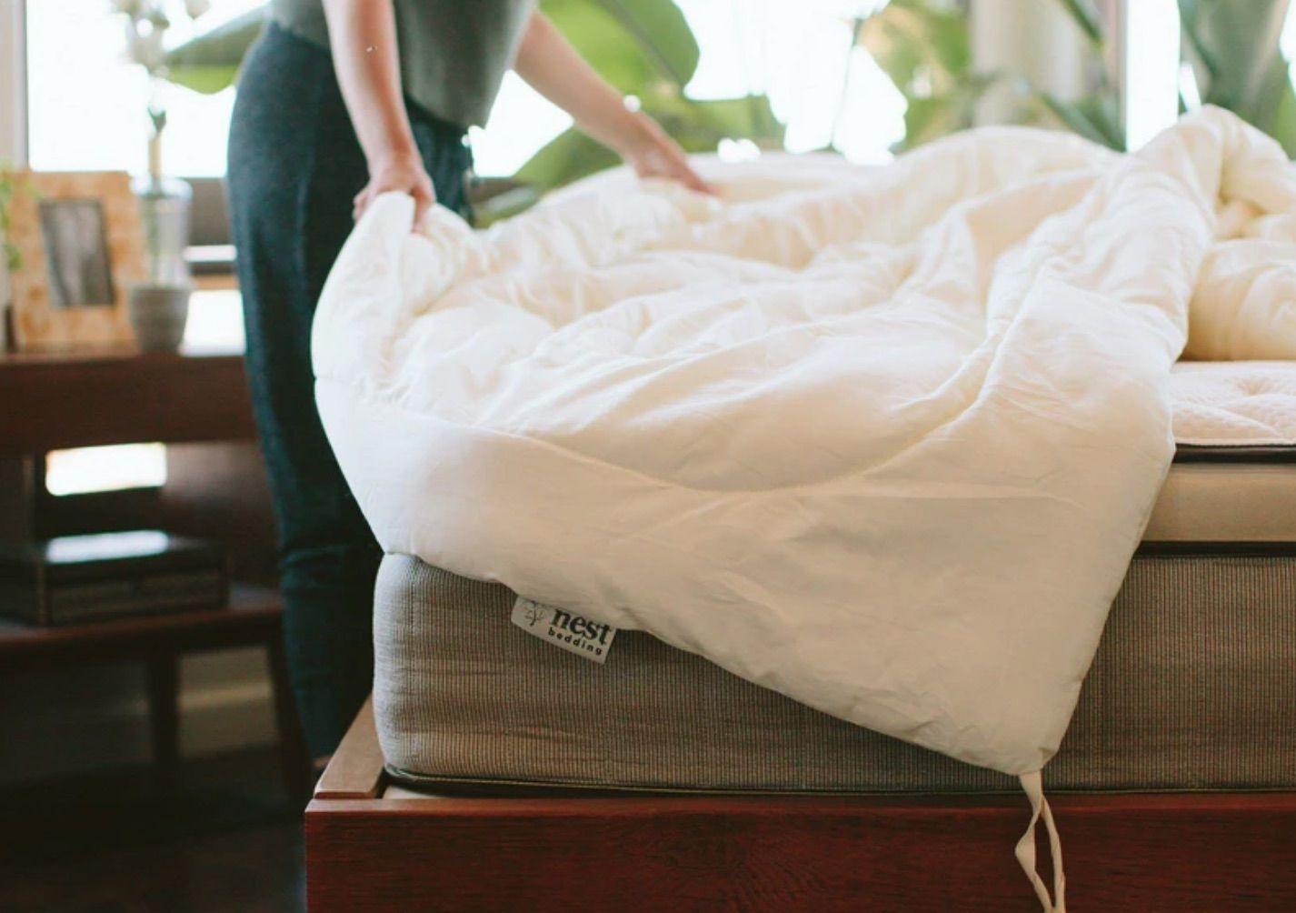 Girl adjusting the bed sheet