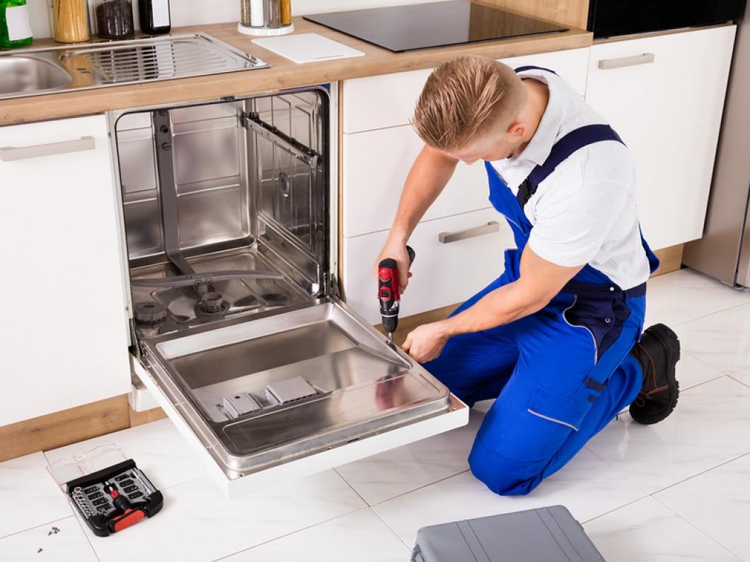 Guy fixing appliance