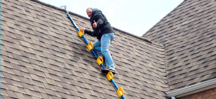 Man using ladder to go on roof
