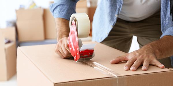 Men taping a box