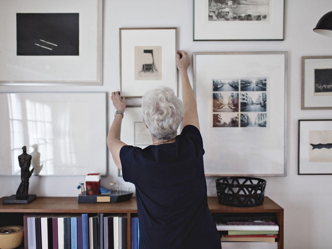 Woman touching wall paintings