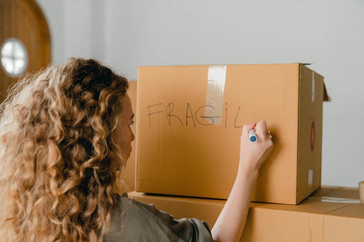 girl packing fragile item