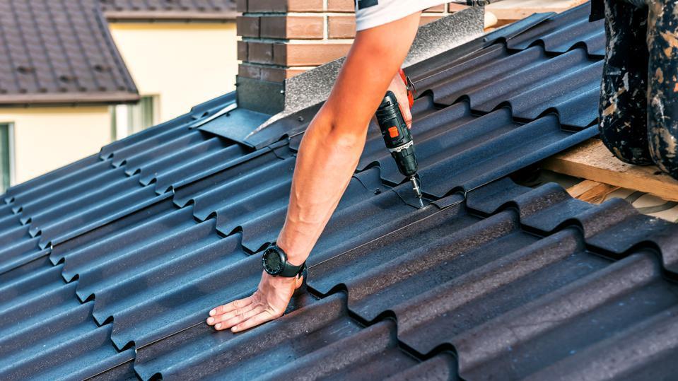 guy installing aluminum roof