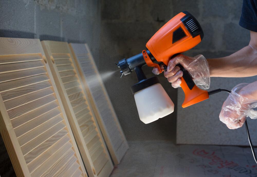spraying paint using paint sprayer
